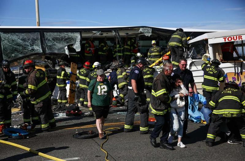 First responders care for victims after a charter bus was struck by a duck amphibious vehicle Thursday on the Aurora Bridge. See more photos at seattlepi.com