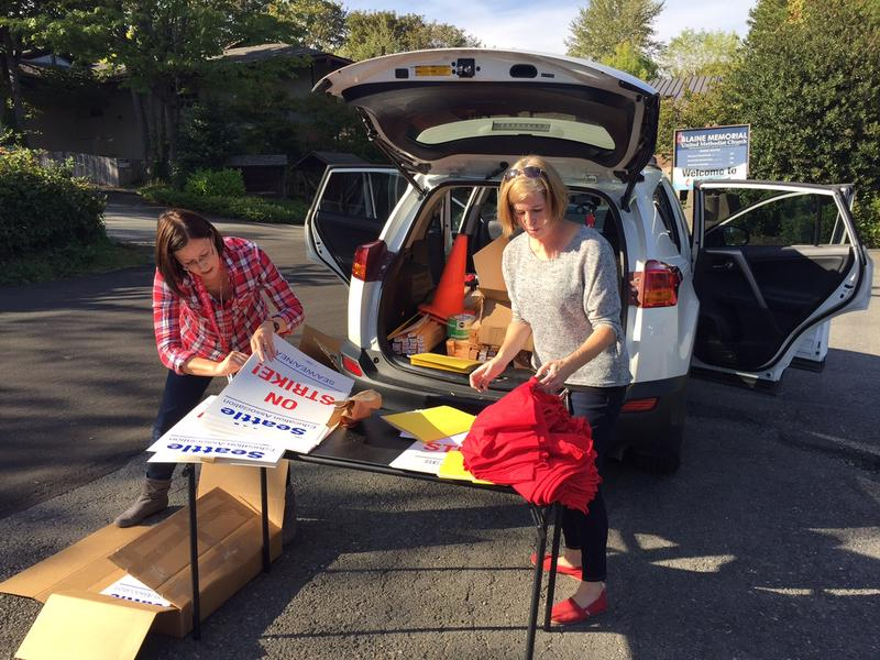 Teachers picked up picket signs and T-shirts on Tuesday afternoon at a church parking lot on Beacon Hill.