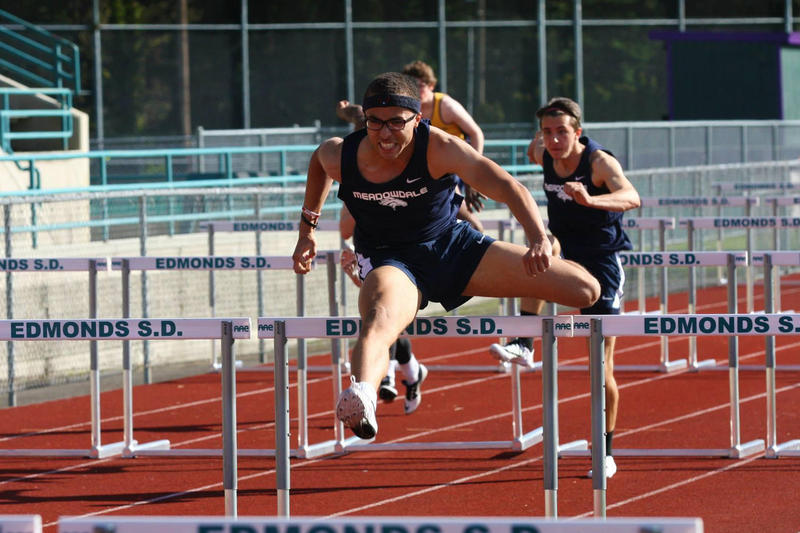 Christapherson Grant runs the 110-meter hurdles race at Edmonds Stadium in spring 2015.