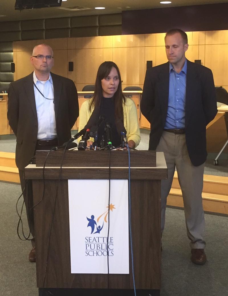 School district spokeswoman Stacy Howard addresses reporters alongside district bargaining team members Jon Halfaker, left, and Keven Wynkoop.
