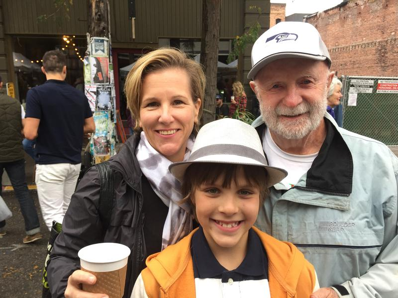 Holly Smith, Holly's son Oliver, and farmer Bill Davidson at the Ballard Farmers' Market.