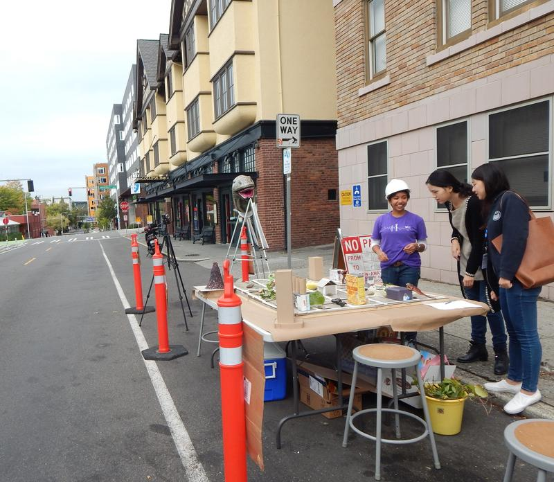Disaster-ready Stephanie Velasco shows Jurassic Parklet to other UW students.