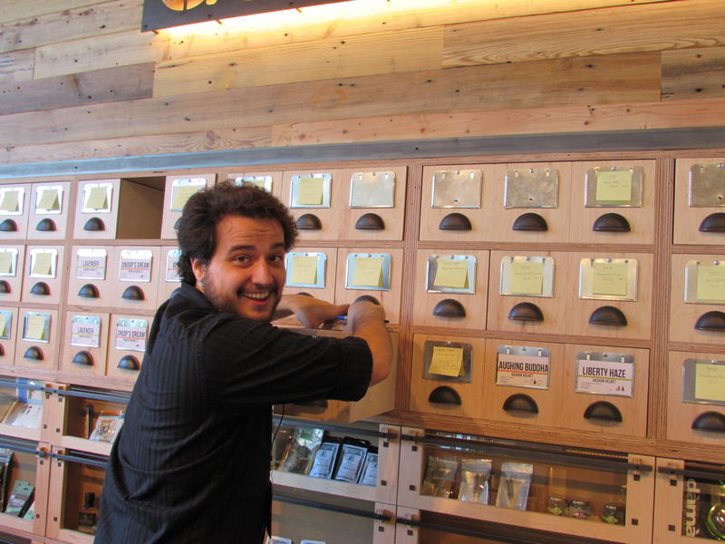 Ben Perez works behind the counter at the new Dockside SODO marijuana retail store.