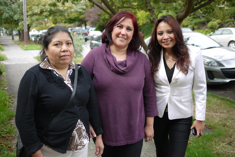 Irene Velazquez, Araceli Hernandez and Angela Escoz prepare for a 100-mile pilgrimage to greet Pope Francis.