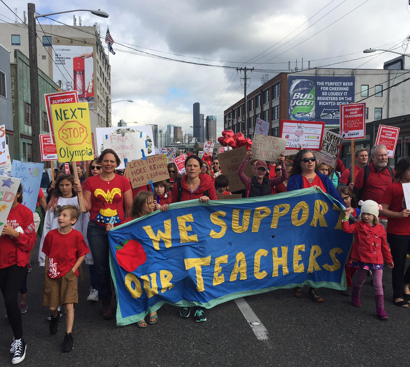 Teachers and supporters march down First Avenue South on their way to the Seattle Public Schools headquarters south of downtown on Tuesday.