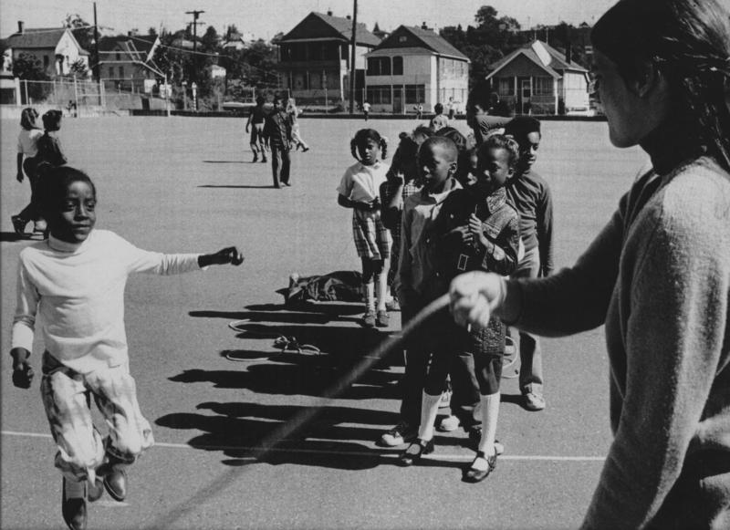 Students play double-dutch at recess at Colman School in 1971. Back then, students had an hour or more time to eat and play at school.