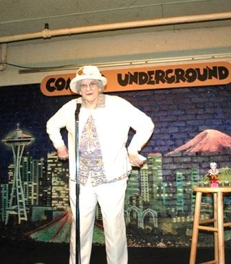Georgie onstage at the Comedy Underground.