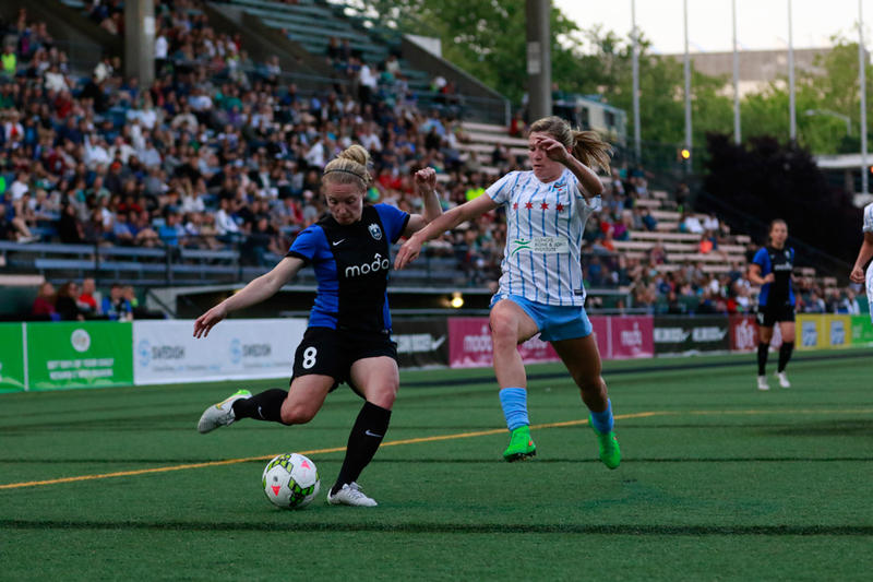 Kim Little (left) of Seattle Reign FC plays at Memorial Stadium in Seattle during an 2015 NWSL match/