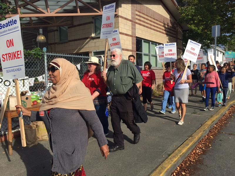 Teachers strike outside Orca K-12 in Columbia City on Wednesday. Seattle Public Schools remains closed Monday as negotiations continue.