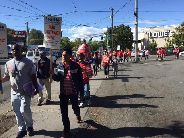 Teachers donned red shirts and picketed outside schools across Seattle on Wednesday. They will vote on whether to strike on Thursday evening.