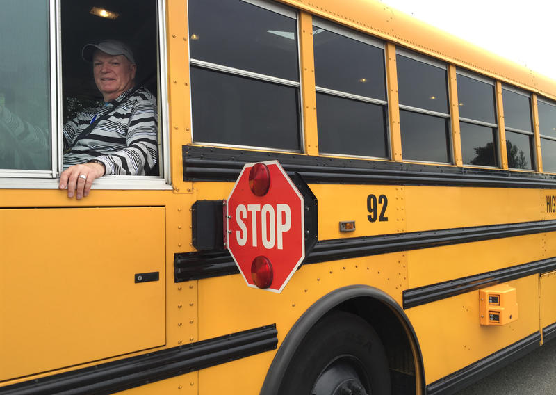 Highline school bus driver Rodger Fowler shows off his stop paddle – and (in the lower-right corner) the camera that captures motorists who ignore the paddle.