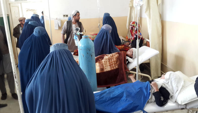Afghan school girls are treated at a hospital after an earthquake in Takhar province, northeast of Kabul, Afghanistan, Monday, Oct. 26, 2015. At least 12 students at a girls' school were killed in a stampede as they fled the shaking building.