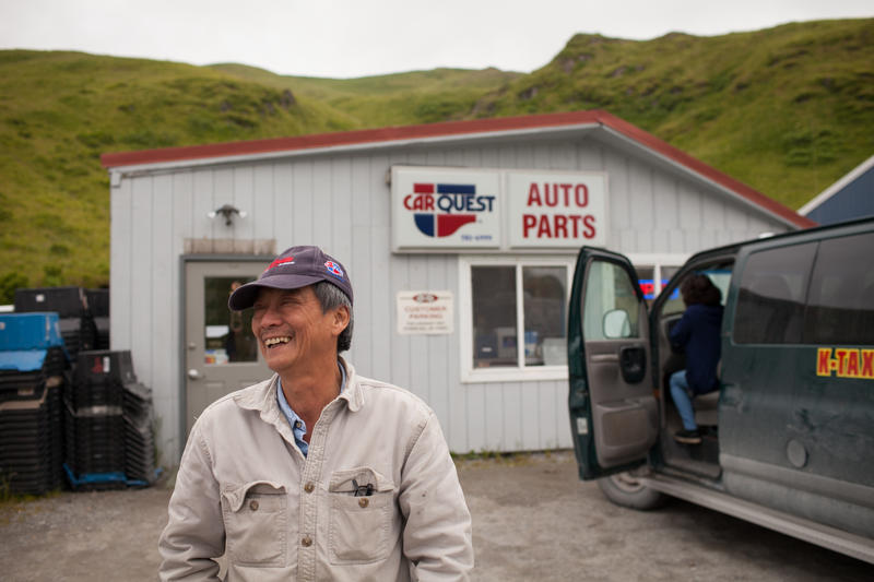 Sonny Nguyen outside of the auto parts store he owns in the town of Unalaska on the port of Dutch Harbor. He's a refugee from Vietnam who moved to Seattle in 1976 and then went to Dutch Harbor where he's lived on and off for 30 years.