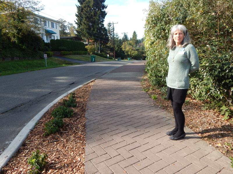 Monica Sweet says cheaper asphalt sidewalks would be a good thing for neighborhoods that have been waiting decades for sidewalks.