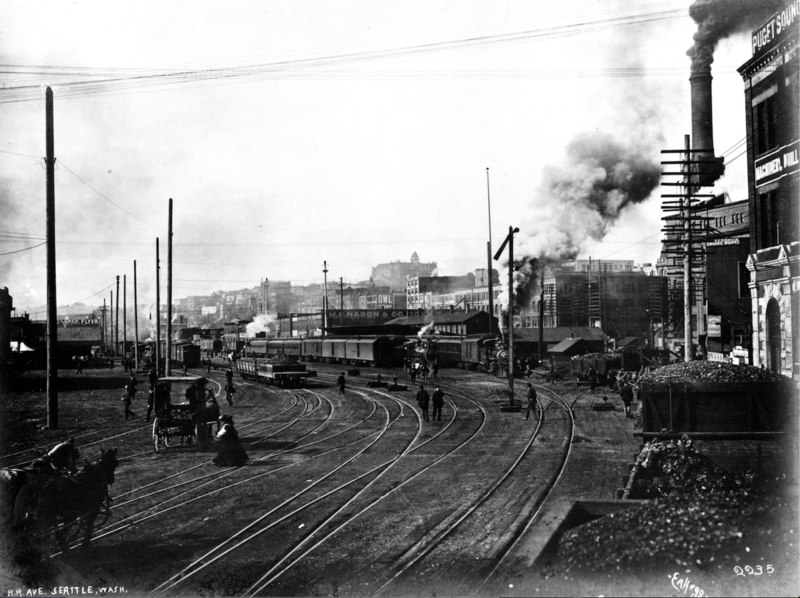 Railroad Avenue, Circa 1905.This looks like a road, but it's actually trestle tracks over Elliott Bay. Occasionally, a pedestrian would happen upon a gap in the trestles and fall through into the water below.