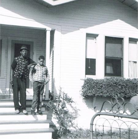 Author Walter Mosley and his father in front of their home in the Watts neighborhood of Los Angeles.