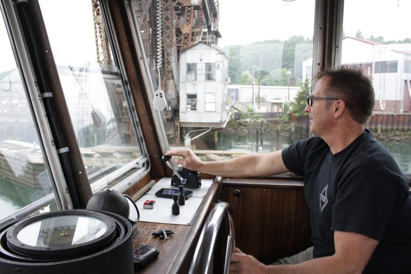 Captain Dave Stauffer of Island Tug and Barge steers a cleaner tugboat these days. No longer is the Duwamish river tracked with exhaust from tugboats leaving behind diesel. Still, problems remain with the health of the people who live nearby.