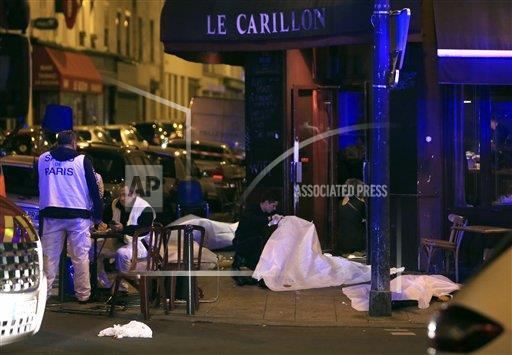 Victims lay on the pavement outside a Paris restaurant after an attack on Friday, Nov. 13, 2015.