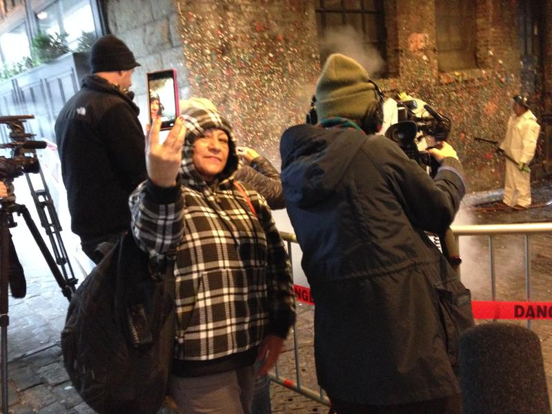 People get selfies of the cleaning of the gum wall at Pike Place Market on Tuesday, Nov. 10, 2015.
