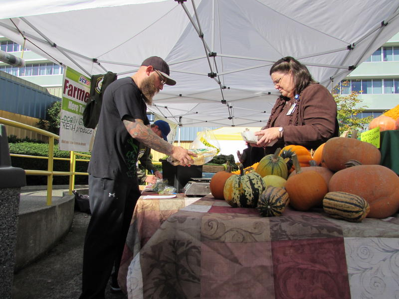Air Force veteran Sean Michael Dalgarn works the Growing Veterans farm stand at the VA Hospital in Seattle. The group's members learn to farm. The harvest is sold here once a week through December.