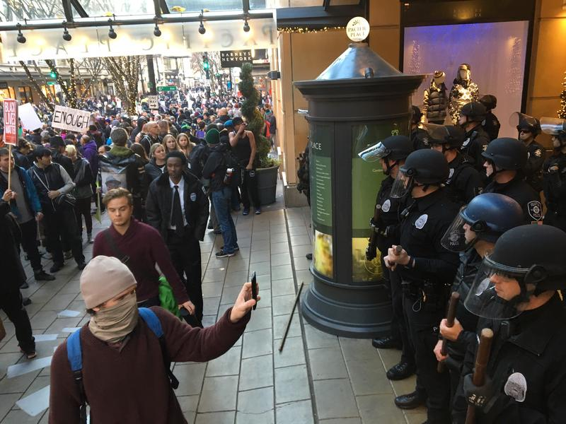 Seattle Police keep Black Lives Matter protesters away from an entrance to Pacific Place shopping center.