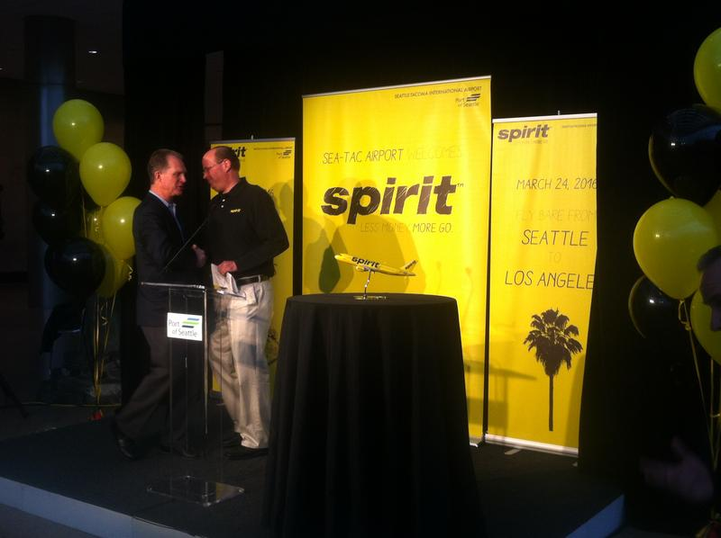 Mark Kopczak from Spirit Airlines shakes hands with Port of Seattle CEO Ted Fick during the announcement Thursday of Spirit's service to Sea-Tac Airport.