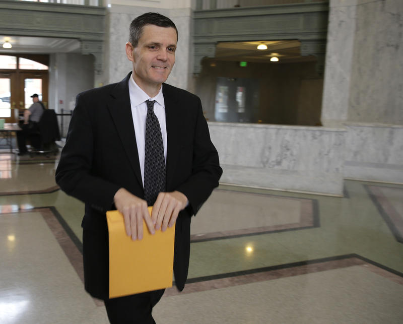 Washington state auditor Troy Kelley arrives at the federal courthouse in Tacoma, Wash., for a hearing Monday, May 11, 2015.