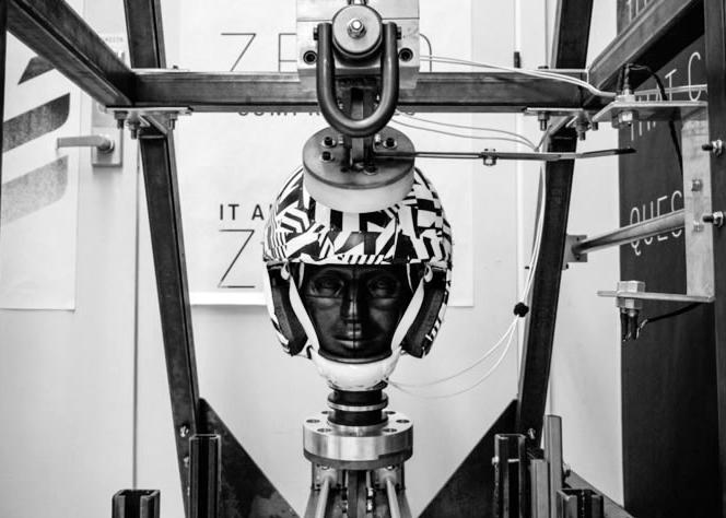 The VICIS helmet is seen in a testing apparatus.