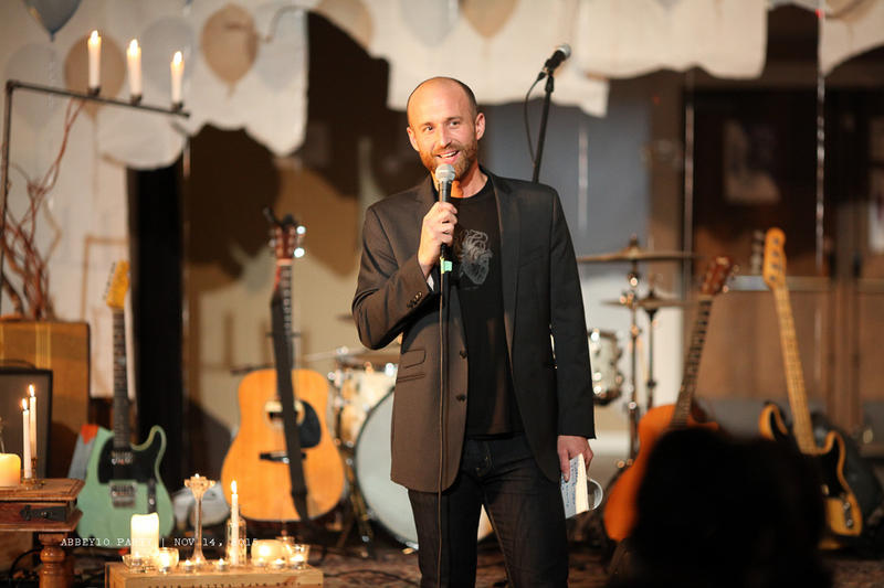 Nathan Marion stands on stage at the Fremont Abbey during a community concert.