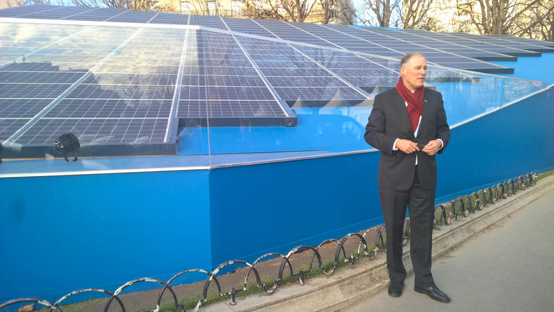 Washington Gov. Jay Inslee, one of the 'super-nationals,' with a solar installation in Paris.