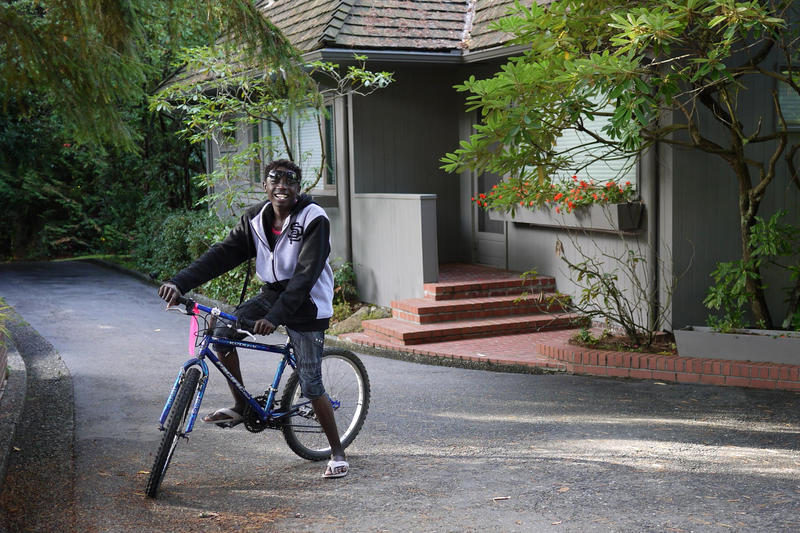 Mario, an 18-year-old refugee from Eritrea, outside his host home in Burien. Mario and his siblings each picked out a bike of their own, thanks to a donation to World Relief.
