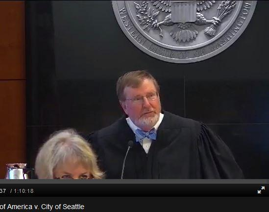 Judge James Robart, of the U.S. District Court in Seattle, presides over his courtroom. Seattle's federal courthouse was part of a pilot to videotape the court.