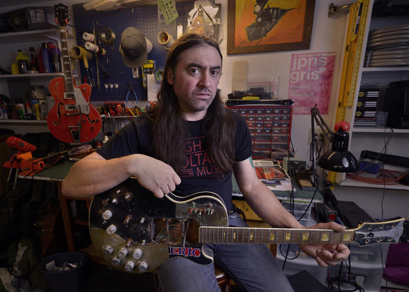 High Voltage Music co-owner Chris Lomba in his backyard shop in north Seattle.