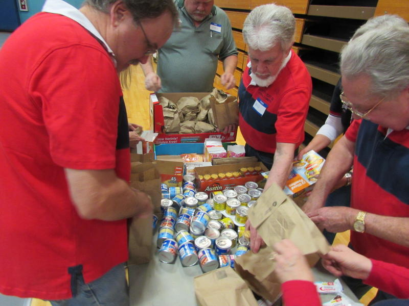 Volunteers from the Elks in Seattle and Shoreline pack take away bags for needy vets at a stand down event.