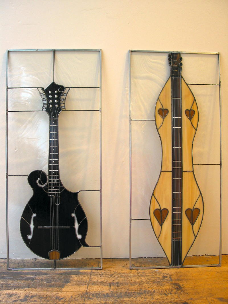A mandolin and a dulcimer represented in stained glass by Joby Shimomura.