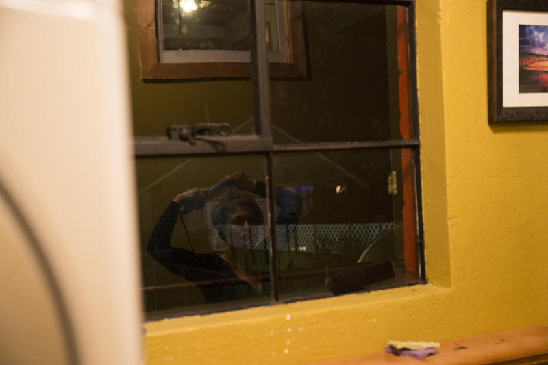 Ericka Frodsham uses a window at the Aurora Commons on Aurora Avenue North. Aurora Commons is a homeless drop-in center. Frodsham got clean years ago and became a nurse; she was later fired for stealing medicine. She lost custody of her children.