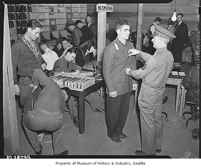 Army recruits in Seattle being fitted for uniforms after the Pearl Harbor attack, 1941.