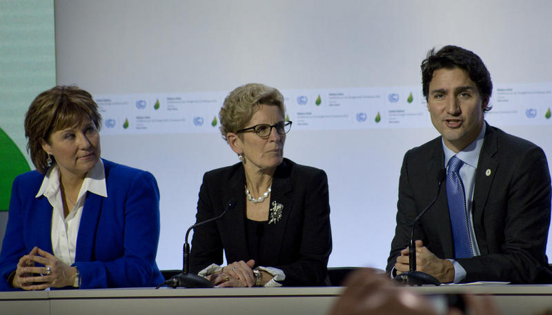 Canada Prime Minister Justin Trudeau, right, speaks at the United Nations COP 21 climate change conference on Nov. 30, 2015.