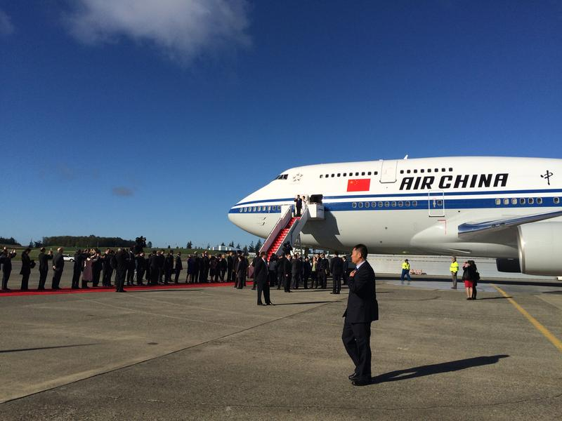 Chinese President Xi Jinping and his wife step out of a Boeing 747 at Everett's Paine Field. China made a splash with its announcement in September that China would buy Boeing planes for its growing air passenger market.