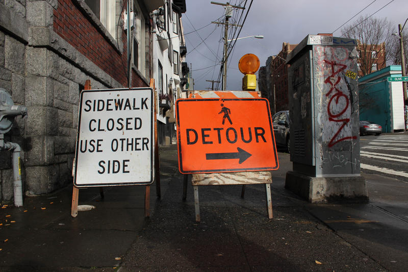Mark Adreon took KUOW on a walk through Capitol Hill to demonstrate how hard it is being blind and navigating the endless construction sites in the city. When he arrived at this spot, the placards through him off course.