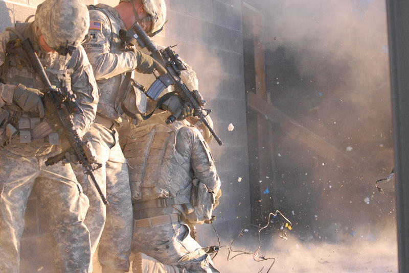 Officers of 1st Stryker Brigade Combat Team, 'Ready First' 1st Armored Division, participate in an urban combat exercise at a training facility on Fort Bliss, Texas in 2011.