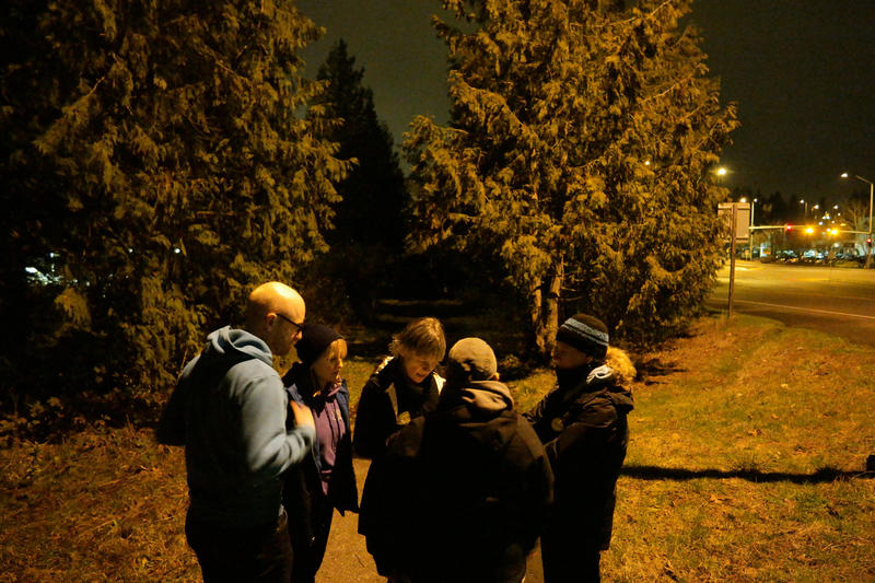 At 4:24 a.m., One Night Count Volunteers Daniel Hubbell, Dusty Udris, Alex O'Reilly, Jude Mercer and Emily Leslie discuss what they saw while searching for homeless people near a shopping center in the Eastside/Bellevue area.