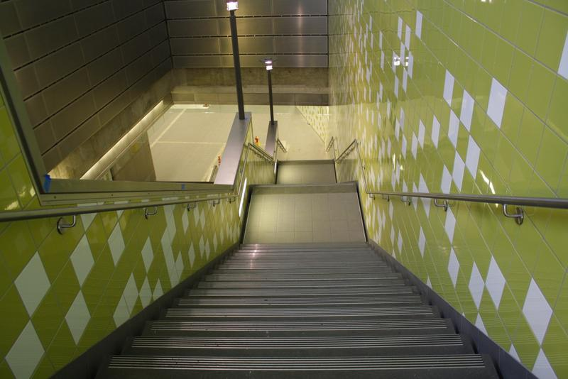 A stairway descends into Capitol Hill's light rail station.
