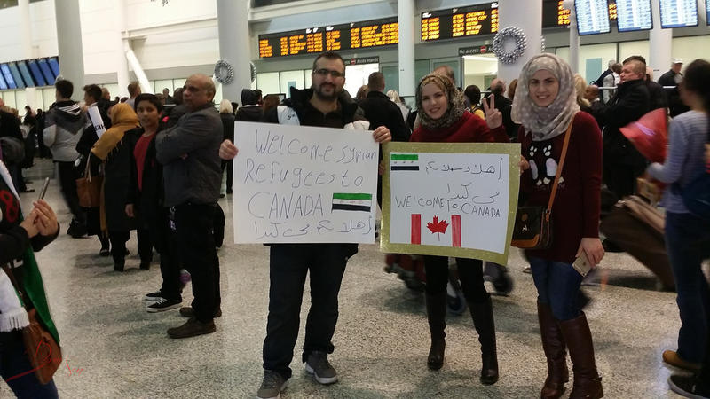 People welcome Syrian refugees at the Toronto airport on Dec. 9, 2015.