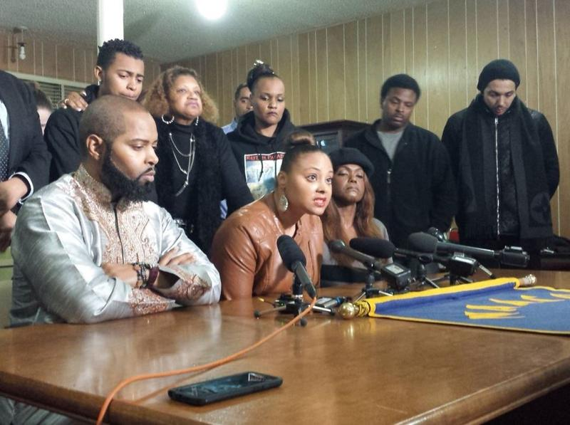 Che Taylor's brother (left), sister (center) and wife appear at an NAACP news conference on Tuesday.