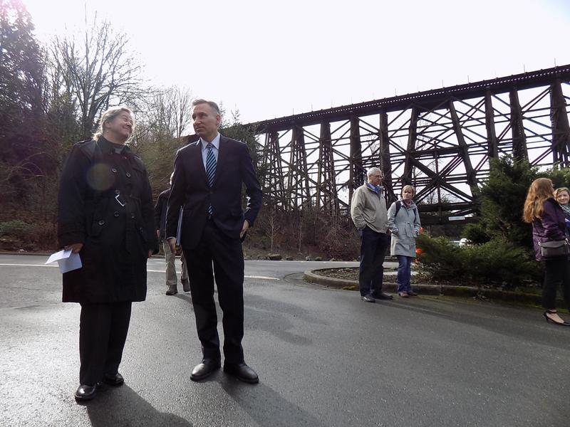 Christie True, who runs the King County parks department,  stands with county executive Dow Constantine before the Wilburton Trestle in Bellevue. A new proposal would put a bike and pedestrian trail atop the historic trestle.