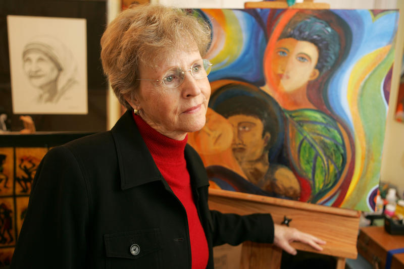 Church abuse victim Mary Dispenza looks on in her studio with her artwork in the background in her Bellevue, Wash., home on Saturday, Dec. 2, 2006.