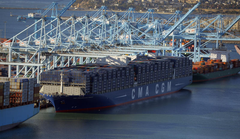 The CMA CGM Benjamin Franklin, the largest container ship to ever make port in North America, unloads its cargo in the Port of Los Angeles in San Pedro, Calif., on Saturday, Dec. 26, 2015.