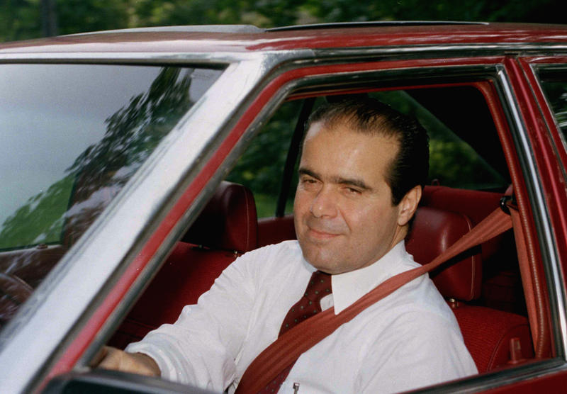 Antonin Scalia departs his McLean, Virginia., residence on Aug. 5, 1986, enroute to Capitol Hill. Scalia was scheduled to appear before the Senate Judiciary Committee which was beginning confirmation hearings on his nomination.