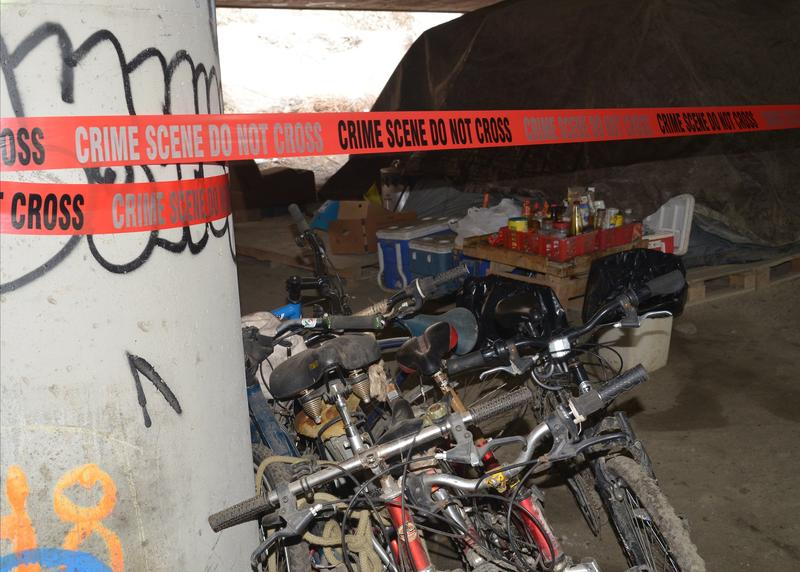Police tape marks the scene of a shooting the left two people dead and three wounded in a homeless camp known as 'The Jungle,' under Interstate 5 in Seattle.